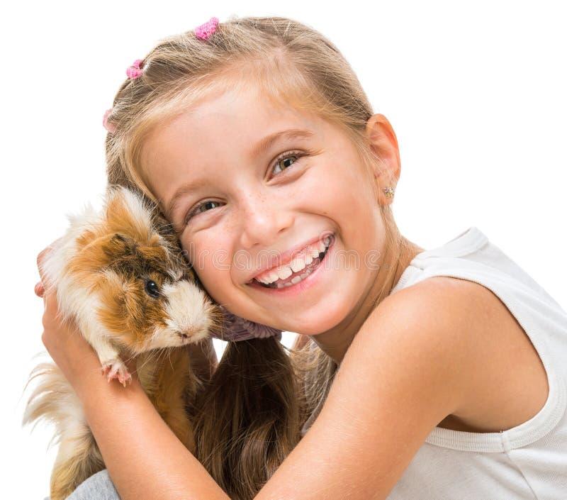 Menina bonito feliz com um cavy imagem de stock royalty free