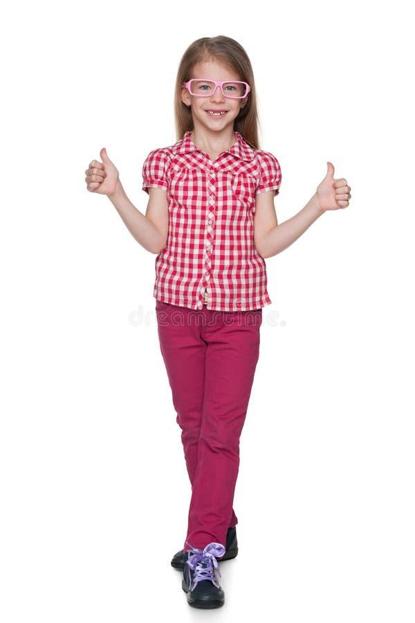 A menina bonito mantém seus polegares foto de stock royalty free