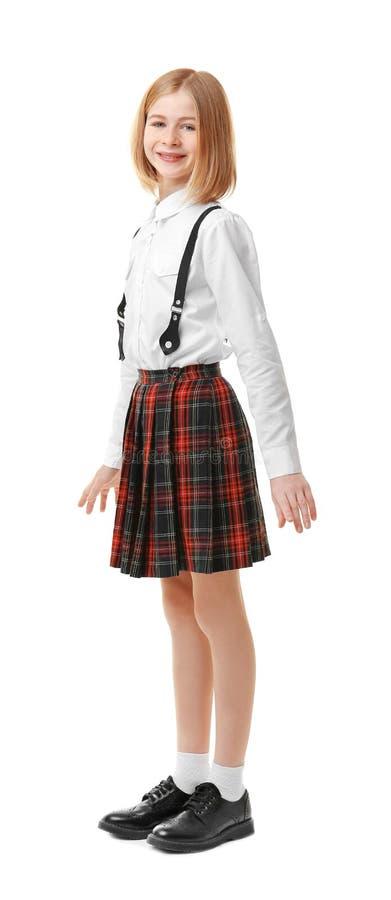 Menina bonito na farda da escola imagem de stock