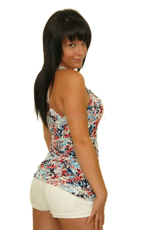 Menina bonito nas calças de brim curtos imagens de stock