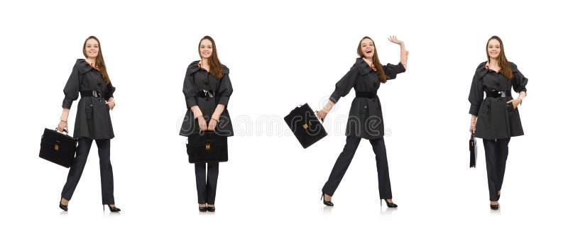 Menina bonito no revestimento escuro morno isolado no branco imagens de stock royalty free
