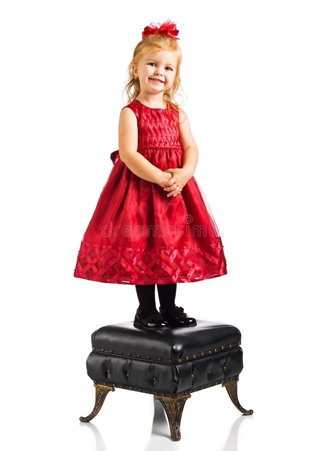 Menina bonito no vestido vermelho imagens de stock