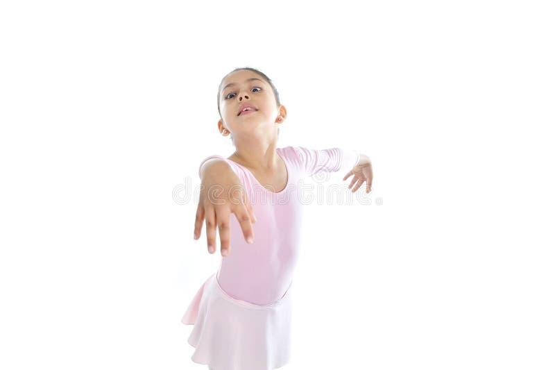 Menina bonito nova da bailarina que dança o tutu vestindo do balé clássico imagens de stock