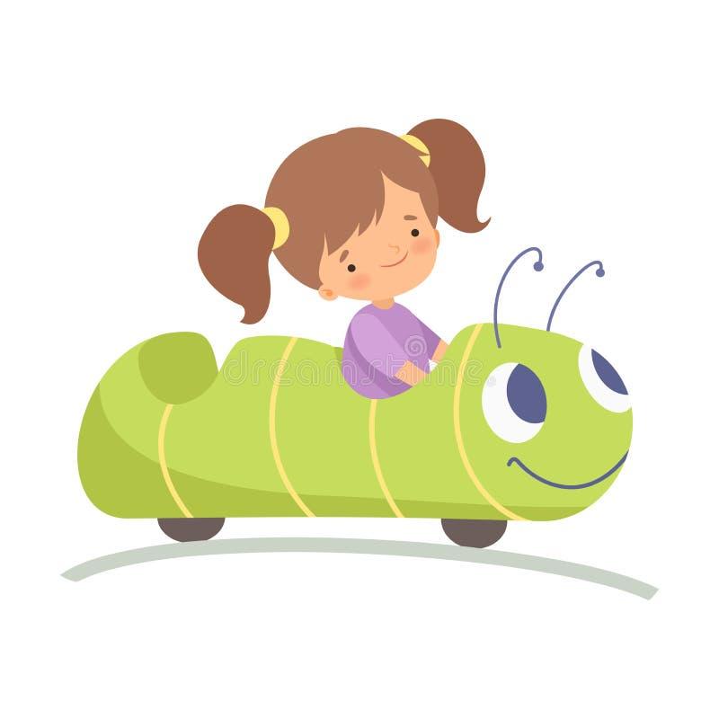 Menina bonito que monta o carro de Caterpillar, criança feliz que tem o divertimento na ilustração do vetor do parque de diversõe ilustração do vetor
