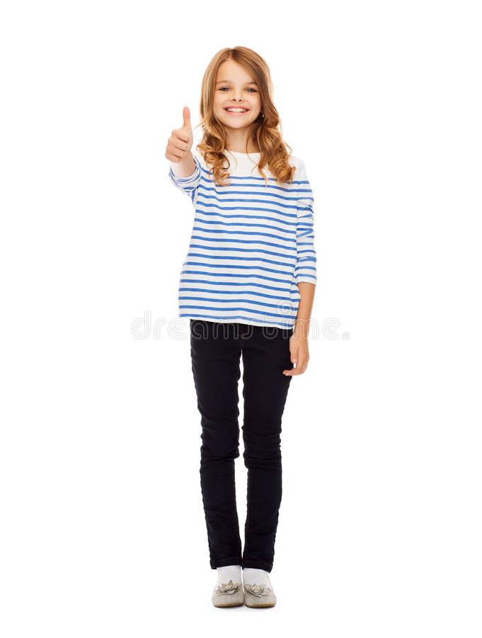 Menina bonito que mostra os polegares acima fotos de stock royalty free