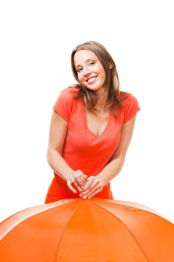 Menina brincalhão do sorriso com guarda-chuva fotografia de stock royalty free