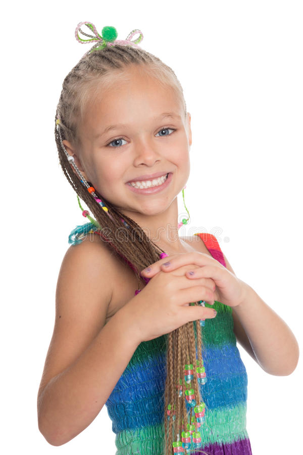 Menina brincalhão que guarda seus dreadlocks imagens de stock royalty free