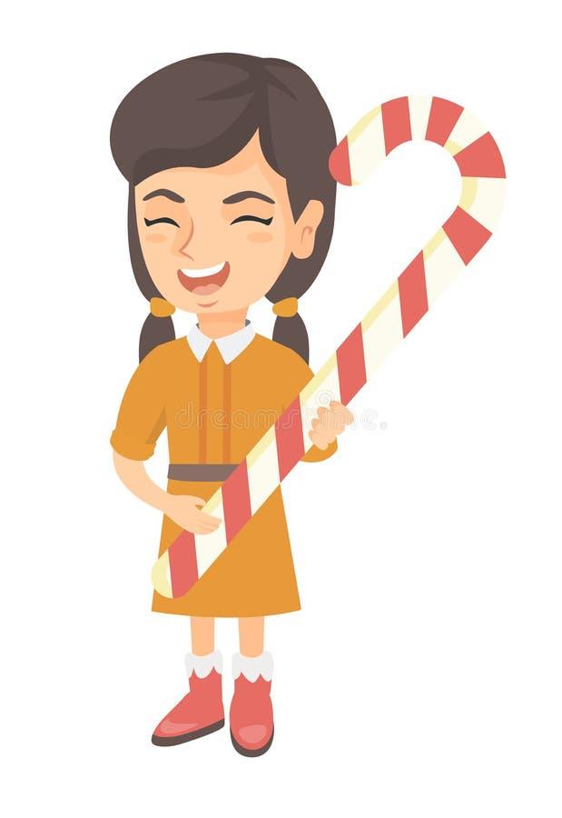 Menina caucasiano que guarda o bastão de doces do Natal ilustração stock