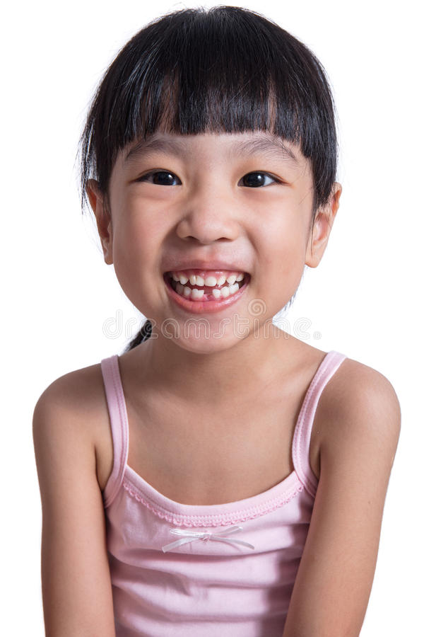 Menina chinesa asiática feliz com sorriso desdentado foto de stock royalty free