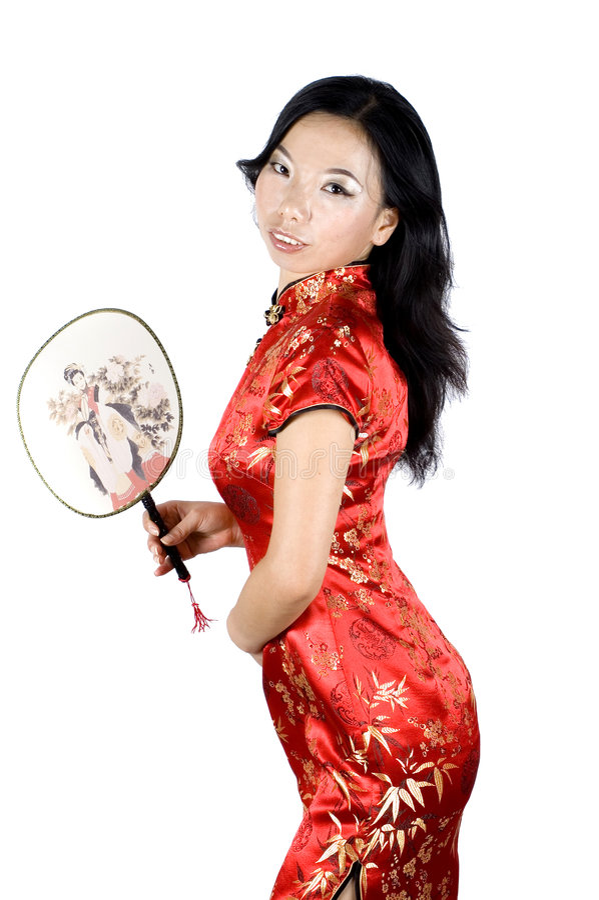 Menina chinesa com ventilador à disposicão imagens de stock royalty free