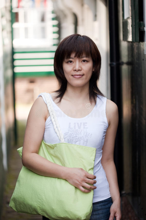 Menina chinesa de sorriso foto de stock