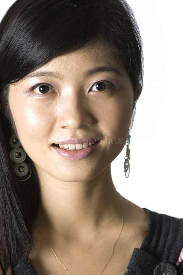 Menina chinesa de sorriso - retrato fotografia de stock