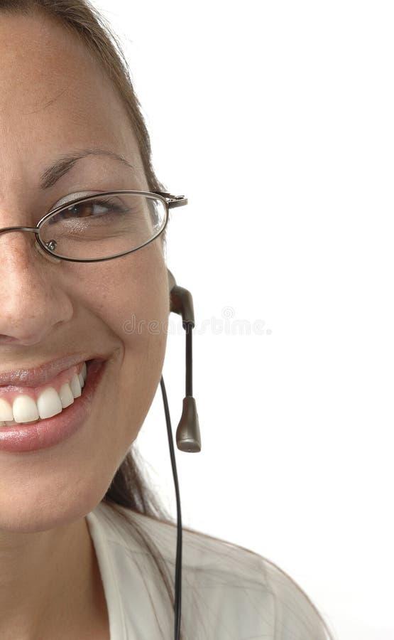 Menina colhida dos auriculares fotografia de stock