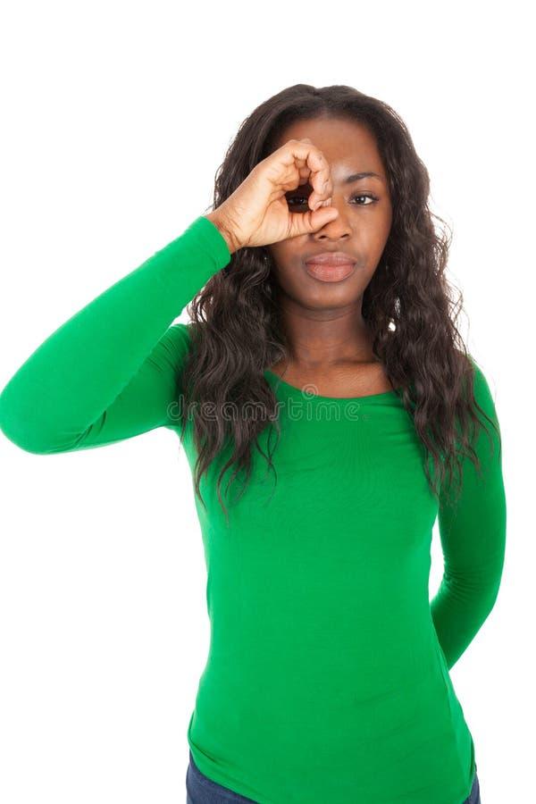 A menina colorida está olhando diretamente na câmera fotografia de stock royalty free