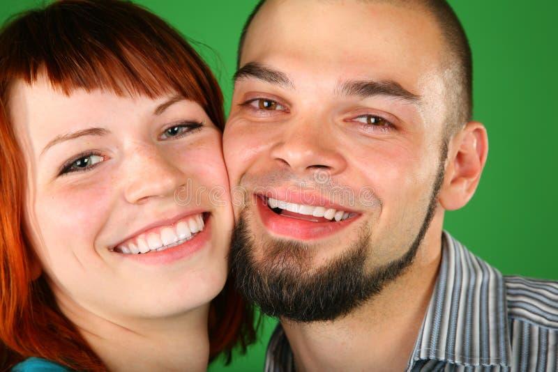 Menina com as faces vermelhas do cabelo e do indivíduo fotografia de stock royalty free