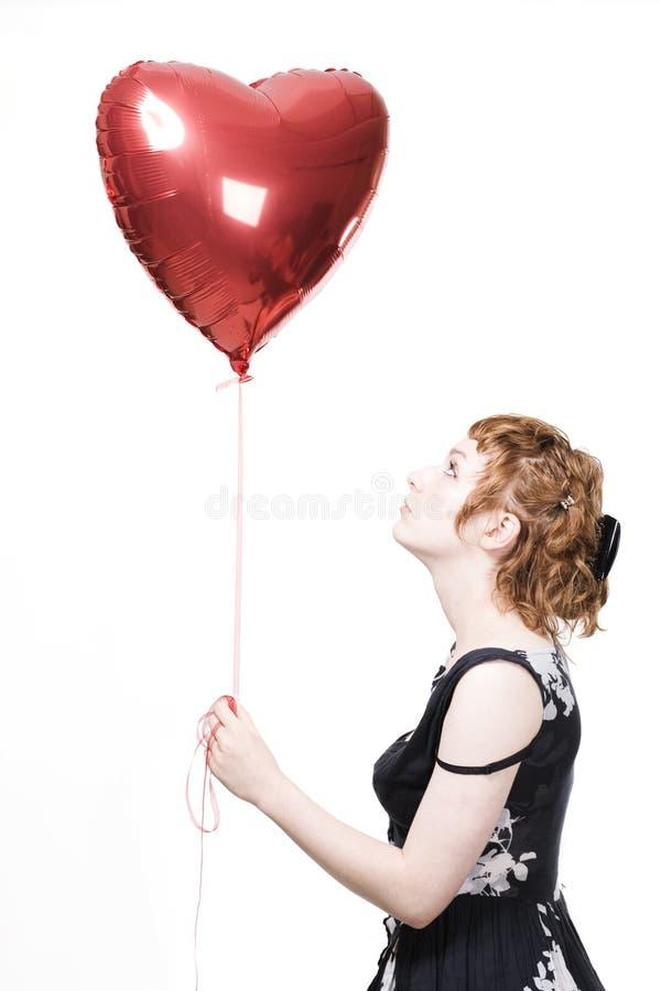 Menina com balão da coração-forma imagem de stock