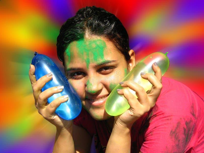 Menina com balões de Holi imagem de stock royalty free