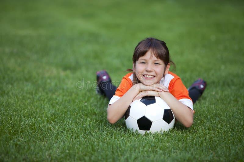 Menina com bola de futebol foto de stock royalty free