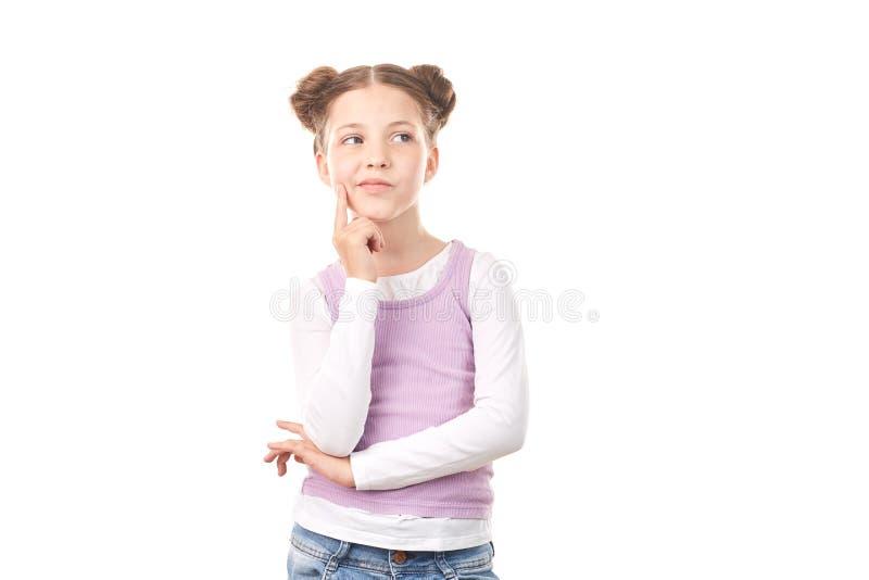 Menina com bolos do cabelo fotografia de stock royalty free