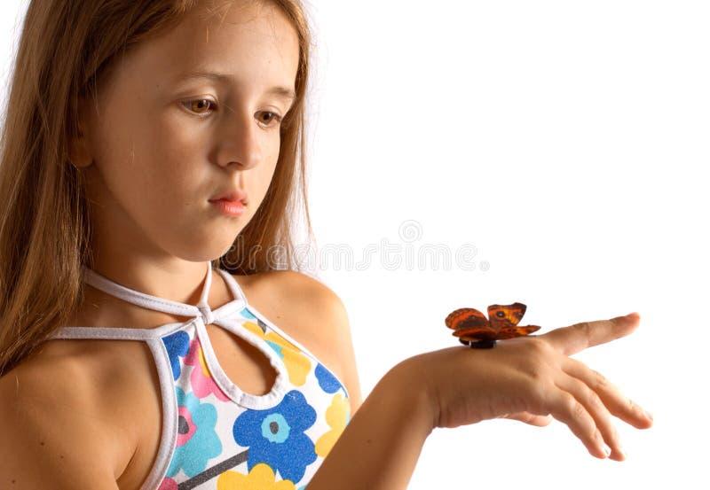 Menina com borboleta artificial imagem de stock royalty free