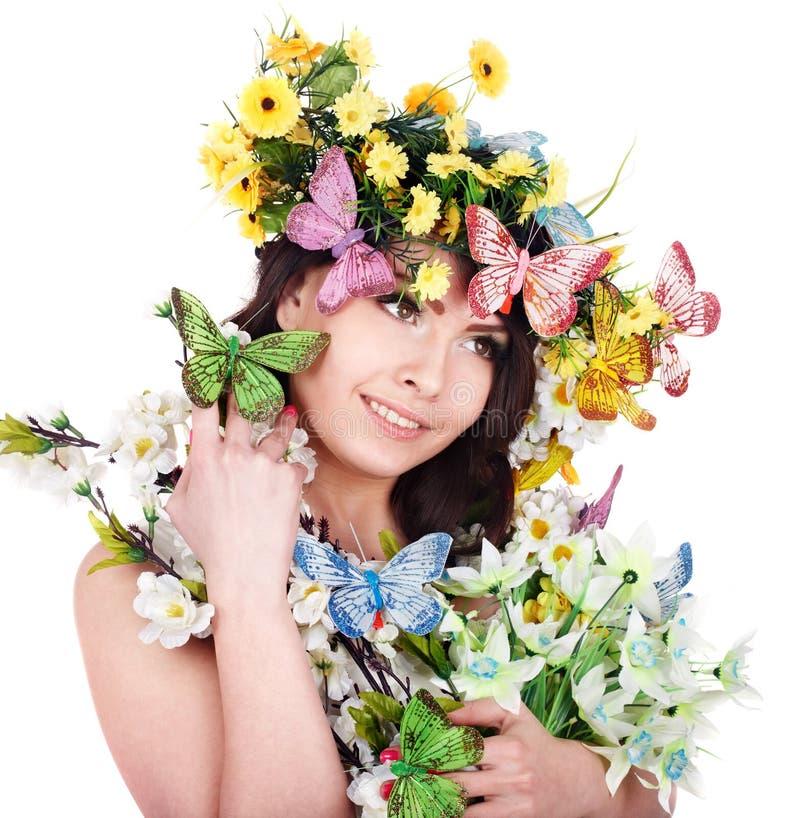 Menina com borboleta e flor na cabeça. fotografia de stock royalty free