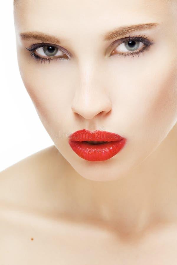 Menina com bordos vermelhos foto de stock