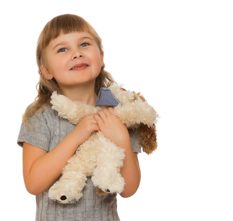 Menina com brinquedo macio foto de stock royalty free