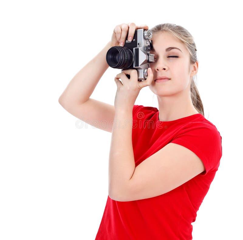 Menina com câmera retro fotografia de stock
