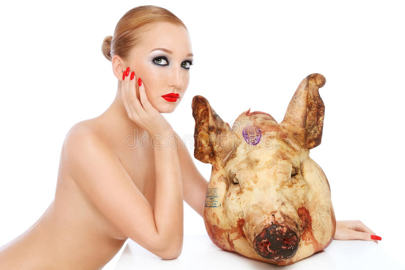 Menina com cabeça do porco foto de stock royalty free