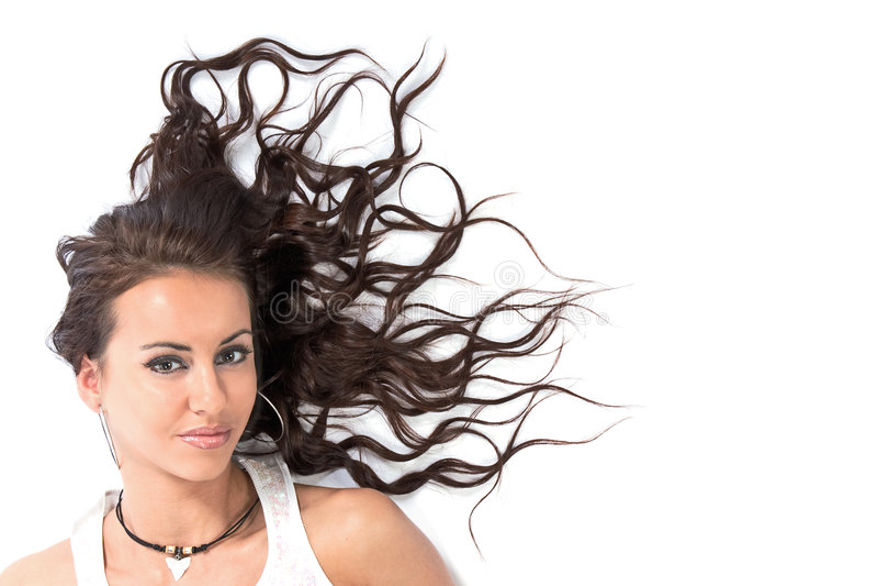 A menina com cabelo dispersado foto de stock