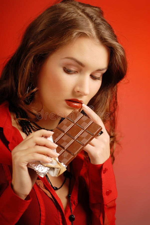 Menina com chocolate fotos de stock royalty free
