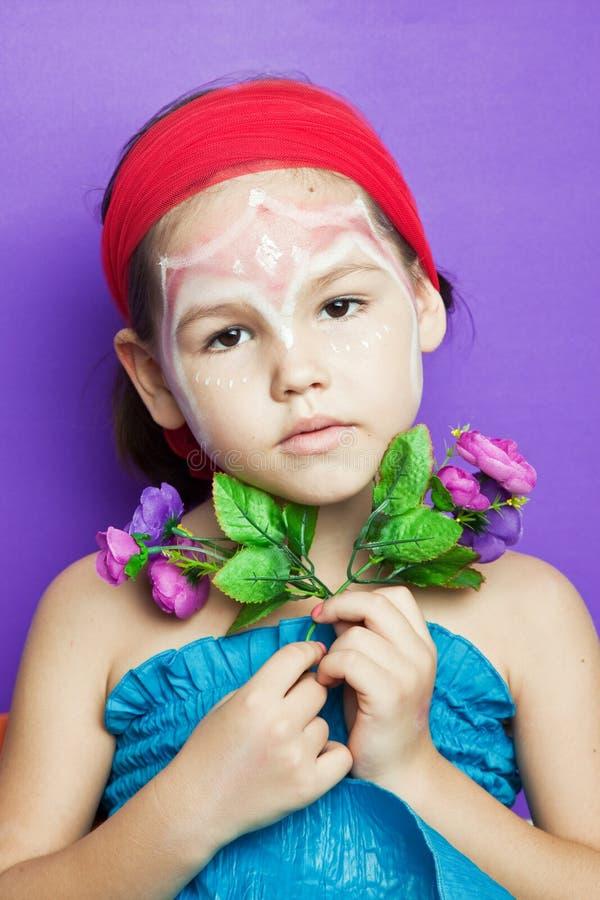 Menina com composição em sua cara fotografia de stock