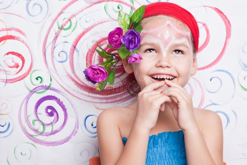 Menina com composição em sua cara imagem de stock royalty free