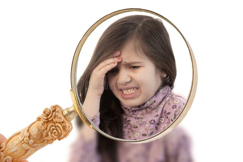 Menina com dor de cabeça imagem de stock royalty free