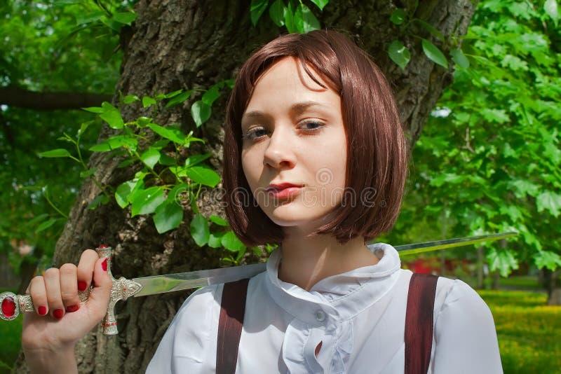 Menina com espada 1 imagens de stock royalty free