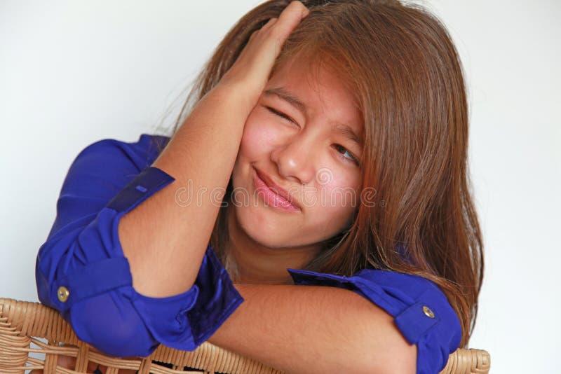 Menina com expressão facial imagem de stock