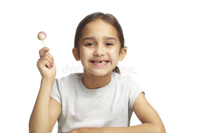 Menina com falta do dente anterior fotos de stock