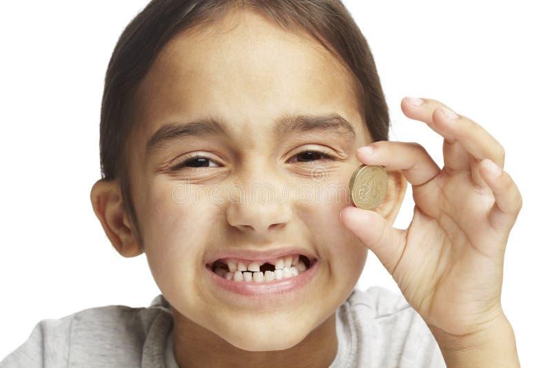 Menina com falta do dente anterior fotografia de stock royalty free