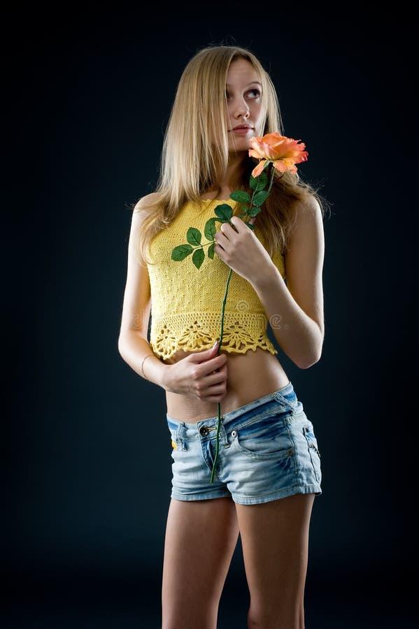 Menina com flor imagem de stock