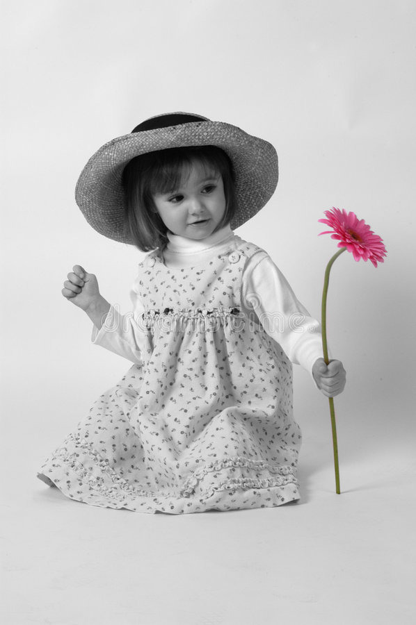 Menina com flor 2 fotografia de stock royalty free