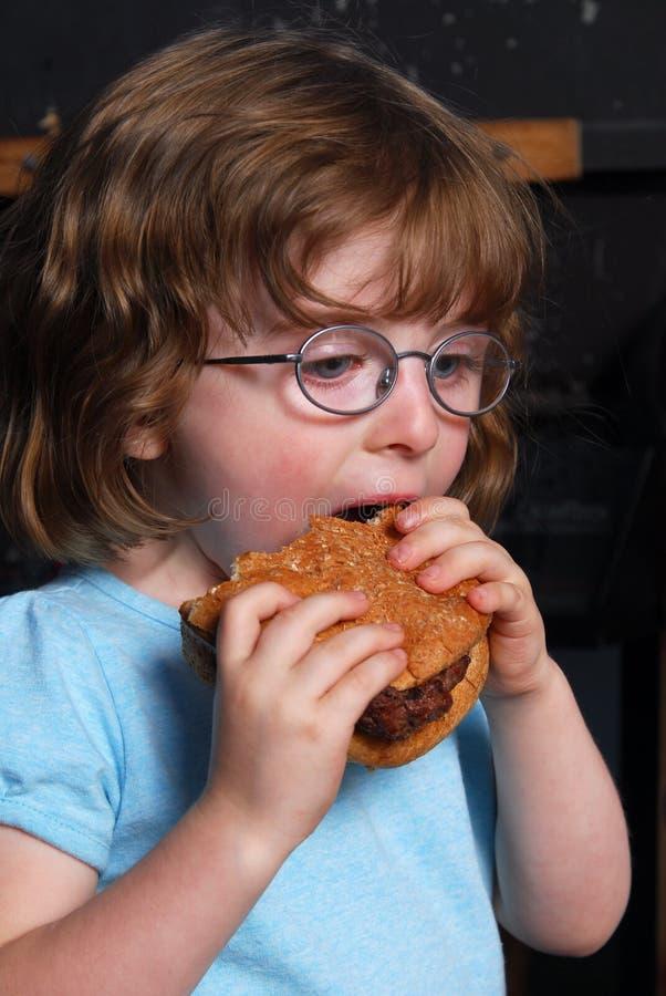 Download Menina com fome foto de stock. Imagem de menina, feliz - 10066460