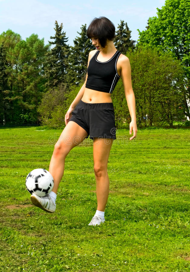 Menina com futebol imagem de stock royalty free