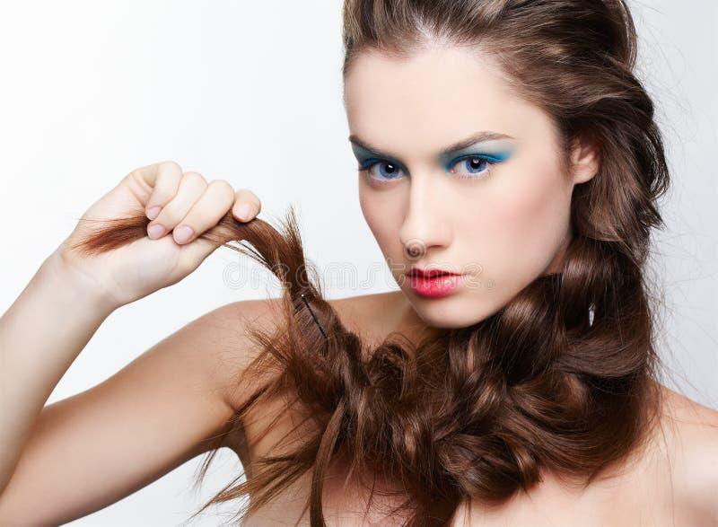 Menina com hair-do creativo fotografia de stock