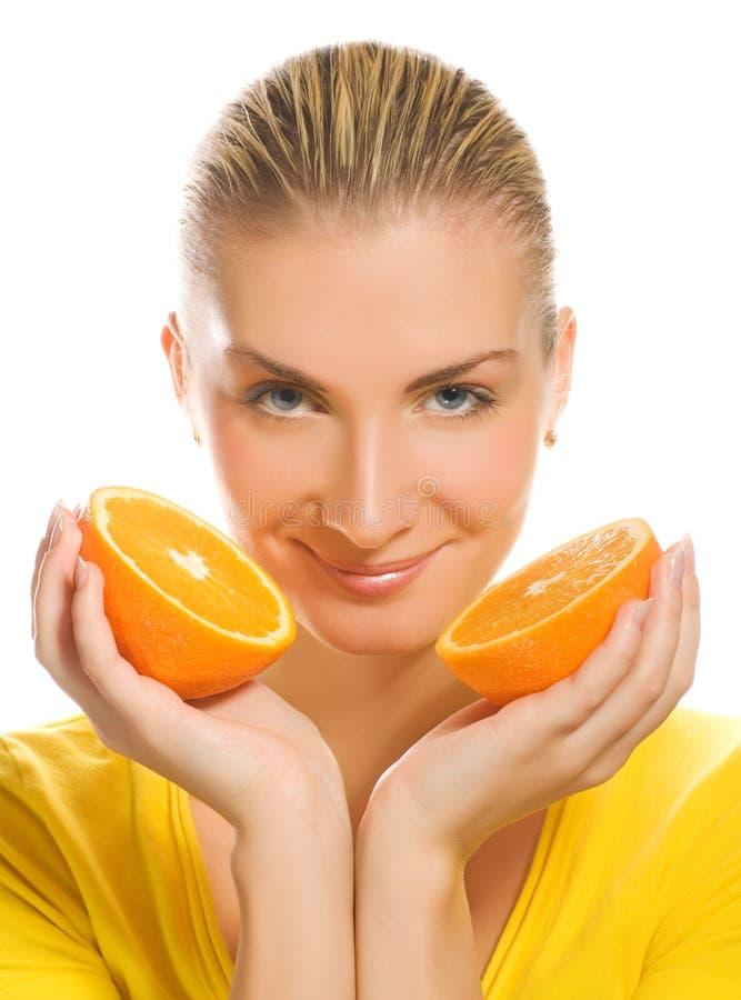 Menina com laranja suculenta fotos de stock royalty free