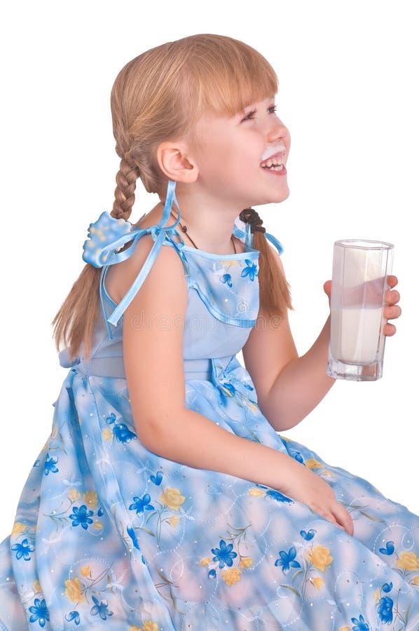 Menina com leite imagem de stock