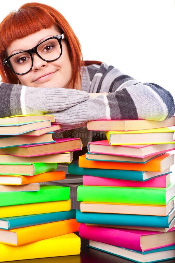 Menina com livro da pilha fotografia de stock royalty free