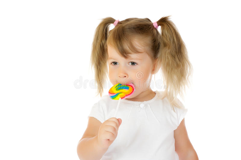 Menina com lollipop fotos de stock royalty free