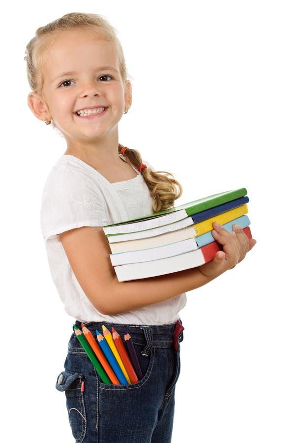 Menina com lotes dos livros imagem de stock royalty free
