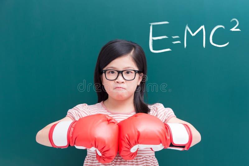 Menina com luva e e=mc2 imagens de stock royalty free
