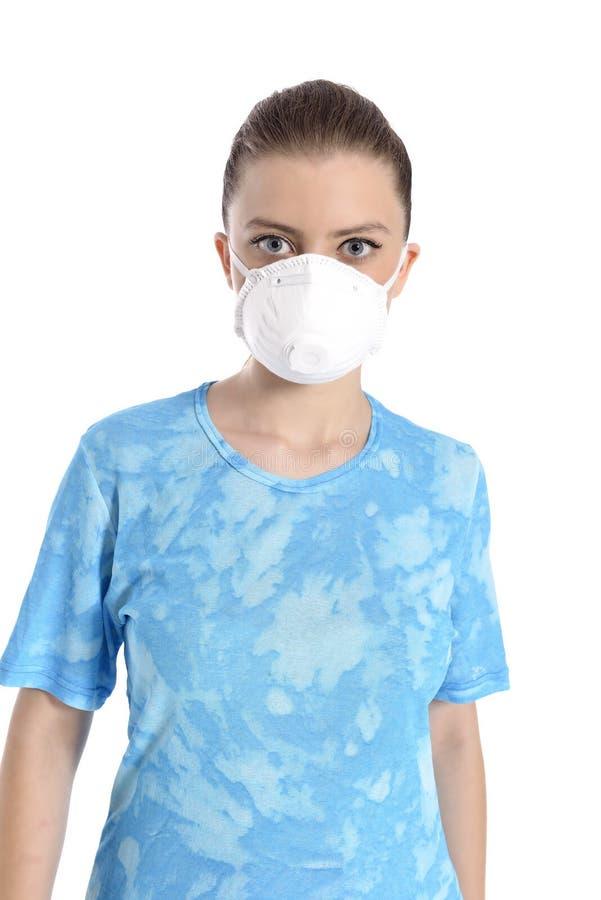 Menina com máscara contra a gripe de suínos foto de stock royalty free